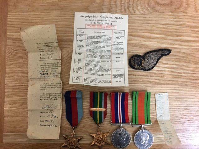 Four medals awarded to Eric Evans and his Bomb-Aimer badge.