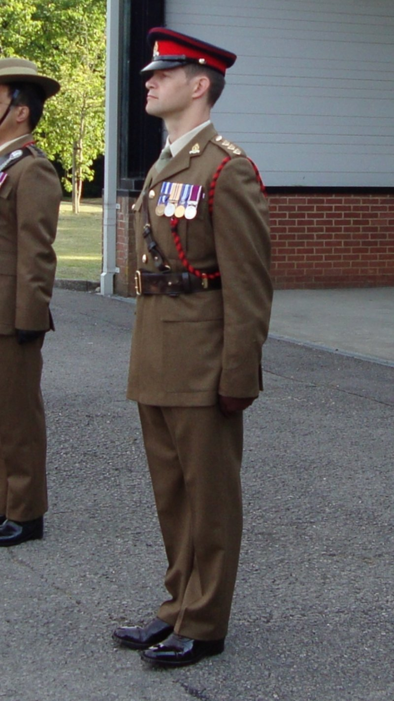 Ian Davies, standing in uniform, ready for inspection.