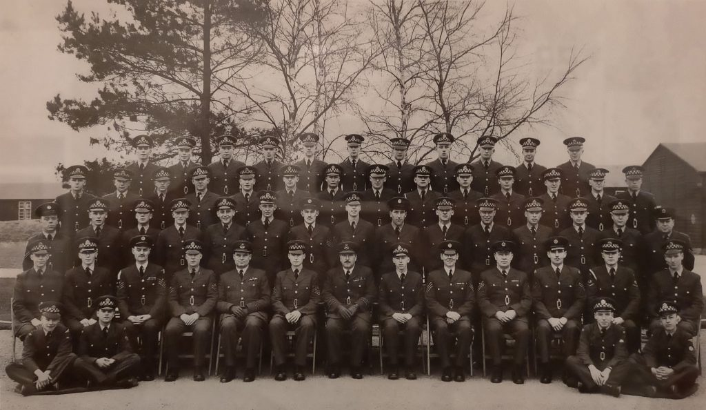 Passing out photo showing No. 3 Squadron of 38th Entry, Supplier II, A Flight at RAF Hereford on March 24th, 1961. John Evans is in the third row, eighth from the left.